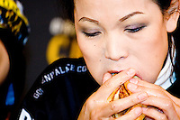 "Sonya Thomas aka ""The Black Widow"" eats as quickly as possible at the I.F.O.C.E. sanctioned Grilled Cheese Eating Competition, held in New York City on February 1, 2006."