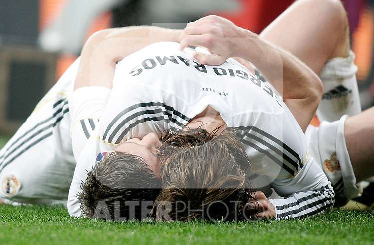 Real Madrid's Sergio Ramos and Xabi Alonso celebrate during La Liga match March 06, 2010. (ALTERPHOTOS/Alvaro Hernandez)