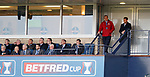 Pedro Caixinha looks on from the back of the stand along with the Rangers directors