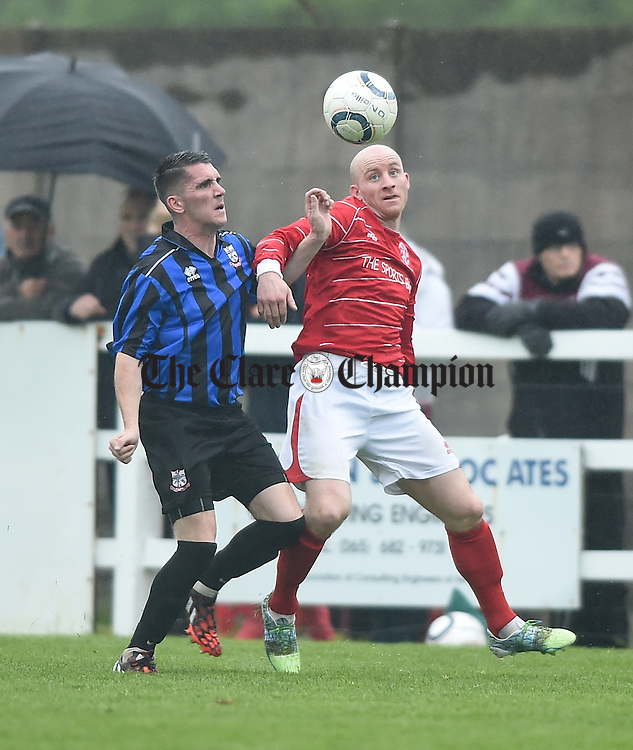 Jason Whyte of Bridge United in action against Alan Brigdale of Newmarket Celtic during their Cup final at Doora. Photograph by John Kelly.