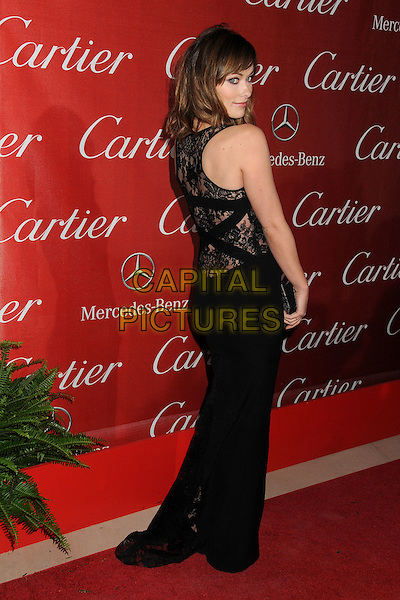 Olivia Wilde.2012 Palm Springs International Film Festival held at the Palm Springs Convention Center, Palm Springs, California, USA, .7th January 2012..arrivals full length black dress sleeveless cut out long maxi clutch bag lace back over shoulder rear behind .CAP/ADM/BP.©Byron Purvis/AdMedia/Capital Pictures.