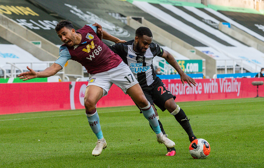 Newcastle United's Danny Rose battles with Aston Villa's Mahmoud Hassan<br /> <br /> Photographer Alex Dodd/CameraSport<br /> <br /> The Premier League - Newcastle United v Aston Villa - Wednesday 24th June 2020 - St James' Park - Newcastle <br /> <br /> World Copyright © 2020 CameraSport. All rights reserved. 43 Linden Ave. Countesthorpe. Leicester. England. LE8 5PG - Tel: +44 (0) 116 277 4147 - admin@camerasport.com - www.camerasport.com