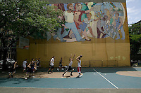 The Far East Ballers, a Japanese street basketball team, practice on a court on 43rd street in New York City, USA, June 19 2005.