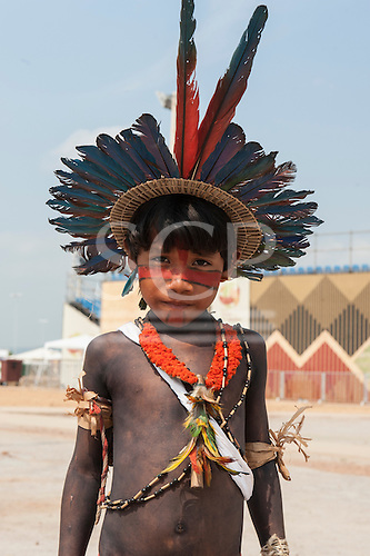 An indigenous boy with face and body paint wears a macaw feather headdress at the International Indigenous Games in tBrazil. 24th October 2015