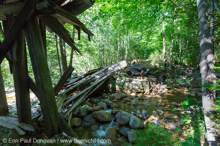 Built in the early 1900s, probably around 1906-1907, the historic Trestle No. 16 crosses Black Brook along the abandoned East Branch & Lincoln Railroad (1893-1948) in the Pemigewasset Wilderness, New Hampshire. Its believed the section of trestle that crossed the brook collapsed in late May or early June 2018. This image shows how the trestle looked in July 2018.