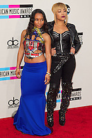 LOS ANGELES, CA - NOVEMBER 24: TLC's Tionne 'T-Boz' Watkins, Rozonda 'Chilli' Thomas arriving at the 2013 American Music Awards held at Nokia Theatre L.A. Live on November 24, 2013 in Los Angeles, California. (Photo by Celebrity Monitor)