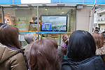 Mar. 11, 2011 - Tokyo, Japan - People watch the devastating news in front of a TV screen. A powerful 8.9-magnitude quake hits north-eastern Japan, tsunami feared.
