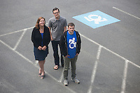 Dr. Brian Glenney (right), Professor of Philosophy at Gordon College, in Wenham, Massachusetts, helped develop the Accessible Icon as part of the Accessible Icon Project.  Cyndi McMahon (left), Director of Marketing Communications at Gordon College, is the volunteer publicist for the Accessible Icon Project and has helped spread usage of the symbol. Tim Ferguson Sauder, Creative Director for Gordon College, is a designer who developed the latest version of the Accessible Icon that features just one wheel and more closely resembles the style of the original International Symbol of Access...The icon is a redesign of the International Symbol of Access (also known as the handicap symbol) that shows an active and engaged person with arms in motion.  Glenney's research focuses on the philosophy of perception and he maintains active interest in graffiti and street art.  The Accessible Icon has been adopted by cities and institutions around the world, including Gordon College, Nissan, New York City, Malden, MA, and others.