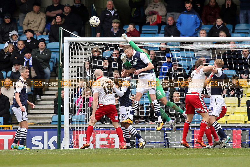 Millwall goalkeeper, Jordan Archer, reaches over his own defender, Mark Beevers, to punch the ball clear during Millwall vs Sheffield United, Sky Bet League 1 Football at The Den on 19th March 2016