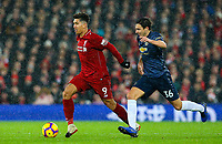Liverpool's Roberto Firmino gets away from Manchester United's Matteo Darmian<br /> <br /> Photographer AlexDodd/CameraSport<br /> <br /> The Premier League - Liverpool v Manchester United - Sunday 16th December 2018 - Anfield - Liverpool<br /> <br /> World Copyright &copy; 2018 CameraSport. All rights reserved. 43 Linden Ave. Countesthorpe. Leicester. England. LE8 5PG - Tel: +44 (0) 116 277 4147 - admin@camerasport.com - www.camerasport.com