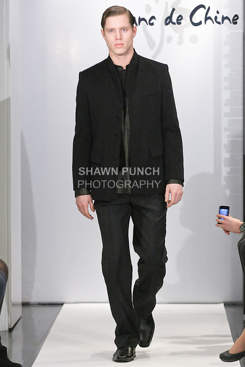 "Model walks runway in an outfit from the Blanc de Chine Fall/Winter 2011 ""The Five Elements"" collection, during New York Fashion Week Fall 2011."