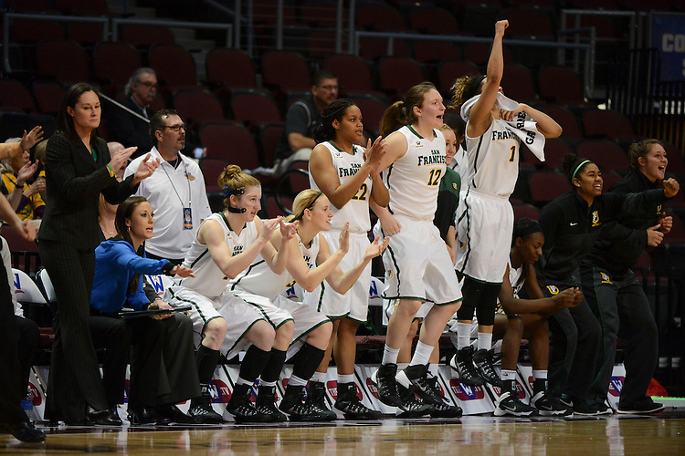 March 6, 2014; Las Vegas, NV, USA; San Francisco Lady Dons team celebrates against the Loyola Marymount Lions during the second half of the WCC Basketball Championships at Orleans Arena.