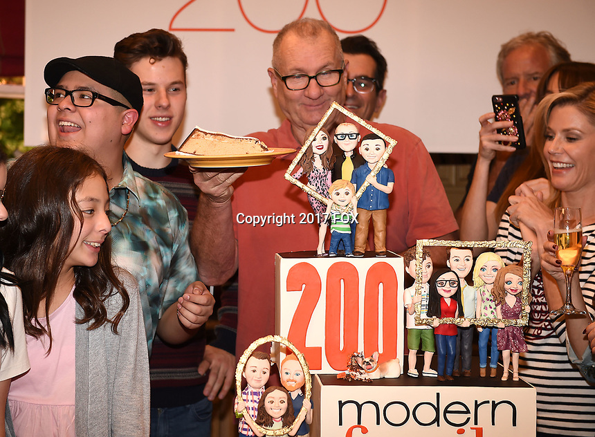 LOS ANGELES - NOVEMBER 15:  Ed O'Neill, Julie Bowen, Ty Burrell, Nolan Gould, Rico Rodrigues, and Aubrey Anderson-Emmons celebrate Modern Family's 200th episode at the Fox Studio Lot on November 15, 2017 in Los Angeles, California. The cake was created by The Butter End. (Photo by Frank Micelotta/Fox/PictureGroup)