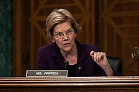 Senator Elizabeth Warren, Democrat of Massachusetts, asks the CFPB Director Kathy Kraninger a question as she testifies before the Senate Banking Committee on Capitol Hill in Washington, D.C. on March 12, 2019. Credit: Alex Edelman / CNP/AdMedia