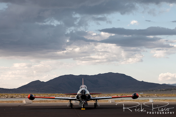 Lockheed T-33 Shooting Star sitting under storm clouds at Stead Field in Reno, Nevada. The T-33 was developed from the Lockheed P-80/F-80 by lengthening the fuselage by slightly over three feet and adding a second seat, instrumentation and flight controls.