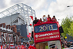 © Joel Goodman - 07973 332324 . 13/05/2013 . Manchester , UK . Manchester United trophy parade on Sir Matt Busby Way , from Old Trafford to Manchester City Centre this evening (Monday 13th May) . The team are celebrating their 20th league title win and commemorating the retirement of manager , Sir Alex Ferguson , by carrying the trophy on an opened top bus through the city . Photo credit : Joel Goodman