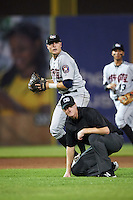 Tri-City ValleyCats third baseman Tyler Wolfe (3) throws to first as umpire Louie Krupa ducks out of the way during a game against the Auburn Doubledays on August 25, 2016 at Falcon Park in Auburn, New York.  Tri-City defeated Auburn 4-3.  (Mike Janes/Four Seam Images)