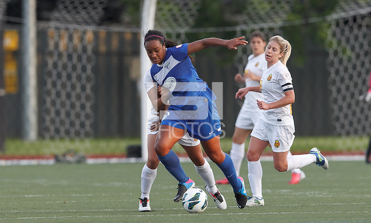Boston Breakers midfielder Mariah Noguiera (20) under pressure controls the ball. In a National Women's Soccer League Elite (NWSL) match, the Boston Breakers (blue) tied Western New York Flash (white), 2-2, at Dilboy Stadium on June 5, 2013.