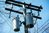 ELECTRIC OIL TRANSFORMERS<br /> Atop Utility Pole<br /> A transformer is a device that transfers electrical energy from one circuit to another through inductively coupled conductors--the transformer's coils.
