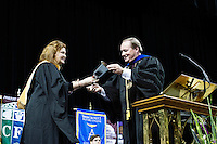 2016 Fall Convocation in Humphrey Coliseum: President Keenum presents cowbell to Maroon Edition author Ashley Rhodes-Courter.<br />  (photo by Megan Bean / &copy; Mississippi State University)