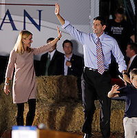 Republican vice presidential nominee Paul Ryan, middle, walks on stage with his wife Janna, left, and family before a rally of about 1,500 during a campaign stop Thursday evening at the Crutchfield Corporation in Albemarle County, Va.
