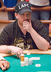 """David Peat thinks about going all in, he does and then reacts to seeing the cards. Peat finsishe in 7th. place, on the """"TV table bubble."""""""