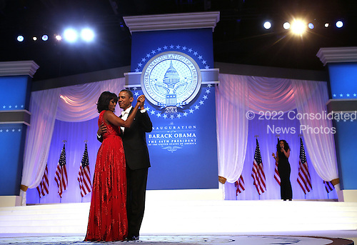 United States President Barack Obama dances with first lady Michelle Obama during the Inaugural Ball January 21, 2013 at Walter E. Washington Convention Center in Washington, DC. Barack Obama was re-elected for a second term as President of the United States..Credit: Alex Wong / Pool via CNP
