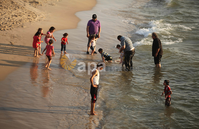 Palestinians enjoy a day at the beach of the Mediterranean Sea on the coast of Gaza City on July 06, 2015. Photo by Ashraf Amra