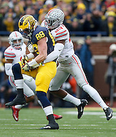 Ohio State Buckeyes safety Tyvis Powell (23) tackles Michigan Wolverines tight end Jake Butt (88) during the NCAA football game at Michigan Stadium in Ann Arbor on Nov. 28, 2015. Ohio State won 42-13. (Adam Cairns / The Columbus Dispatch)