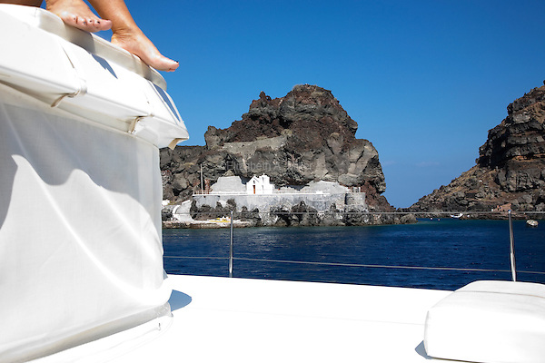View of the caldera and a church from the water sailing south in Santorini, Greece on July 5, 2013.