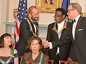 Singer-songwriter Sting, top left, one of the five recipients of the 2014 Kennedy Center Honors, shakes hands with Michael Stevens, top ight, writer and producer of the annual Kennedy Center Honors as he waits to pose for a group photo following a dinner hosted by United States Secretary of State John F. Kerry at the U.S. Department of State in Washington, D.C. on Saturday, December 6, 2014.  Pictured are fellow honorees are: singer Al Green, top center, ballerina Patricia McBride, bottom left, and comedienne Lily Tomlin, bottom right.<br /> Credit: Ron Sachs / CNP