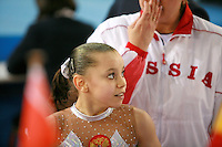Daria Elizarova of Russia smiles with coaches during junior women's event final competition at 2006 European Championships Artistic Gymnastics at Volos, Greece on April 30, 2006.  (Photo by Tom Theobald)<br />