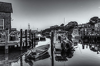 The commercial fishing village of Menemsha and boats docked in Menemsha Basin during morning twilight, in Chilmark, Massachusetts on Martha's Vineyard.