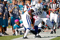 October 03, 2010:   Jacksonville Jaguars wide receiver Mike Thomas (80) looses his helmet and is knocked out of bounds by Indianapolis Colts defensive tackle Antonio Johnson (99) and Jerraud Powers during 1st half AFC South Conference action between the Jacksonville Jaguars and the Indianapolis Colts at EverBank Field in Jacksonville, Florida.   Jacksonville defeated Indianapolis 31-28........