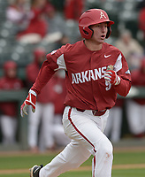 NWA Democrat-Gazette/ANDY SHUPE<br />Arkansas shortstop Jax Biggers runs to first Saturday, April 14, 2018, after hitting against South Carolina to end the fifth inning at Baum Stadium. Visit nwadg.com/photos to see more photographs from the game.