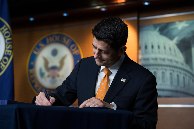 UNITED STATES - JULY 26: Speaker Paul Ryan, R-Wis., signs Strengthening Career and Technical Education for the 21st Century Act during his last news conference before the House leaves for the August recess on July 26, 2018. (Photo By Tom Williams/CQ Roll Call)