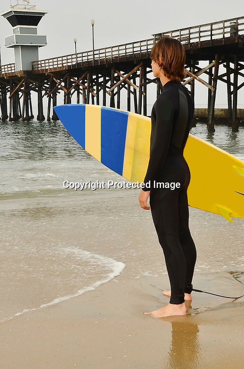 Stock photo of a teenage surfer at an Orange County California Beach
