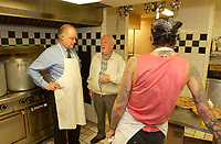 Montreal, October 27th 2001<br /> <br /> &quot;Dans la rue&quot; founder father Emmett Johns a.k.a. &quot;Pops&quot; (M) gives a guided tour of the   kitchen to  Andr&Egrave; Caill&Egrave; (L ); president and CEO of Hydro Quebec  and honorary chairman of  it's 2001 fundraising campaign, at the organization headquarters located at 1664 Ontario East, in Montreal, CANADA, on Tuesday, November 27.<br /> <br /> Caill&Egrave; served lunch to the young people who use the day centre and those who stop by.<br /> <br /> &quot;Dans la rue&quot;, an organization founded in 1988 by father Emmett Johns a.k.a. &quot;Pops&quot; is well known for the services offered by the Roulotte, an emergency shelter and day centre. . This year's goal is to raise $2.5 million to help Montreal's 5,000 young homeless people<br /> throughout the year.<br /> <br /> <br /> Photo by Sevy-IMAGES DISTRIBUTION <br /> <br /> NOTE :  D-1 H original JPEG, saved as Adobe 198 RGB