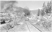 Rear view of eastbound D&amp;RGW train headed down the Monarch Branch at the Garfield Highway 50 crossing.<br /> D&amp;RGW  Garfield, CO  Taken by Richardson, Robert W. - 9/23/1948