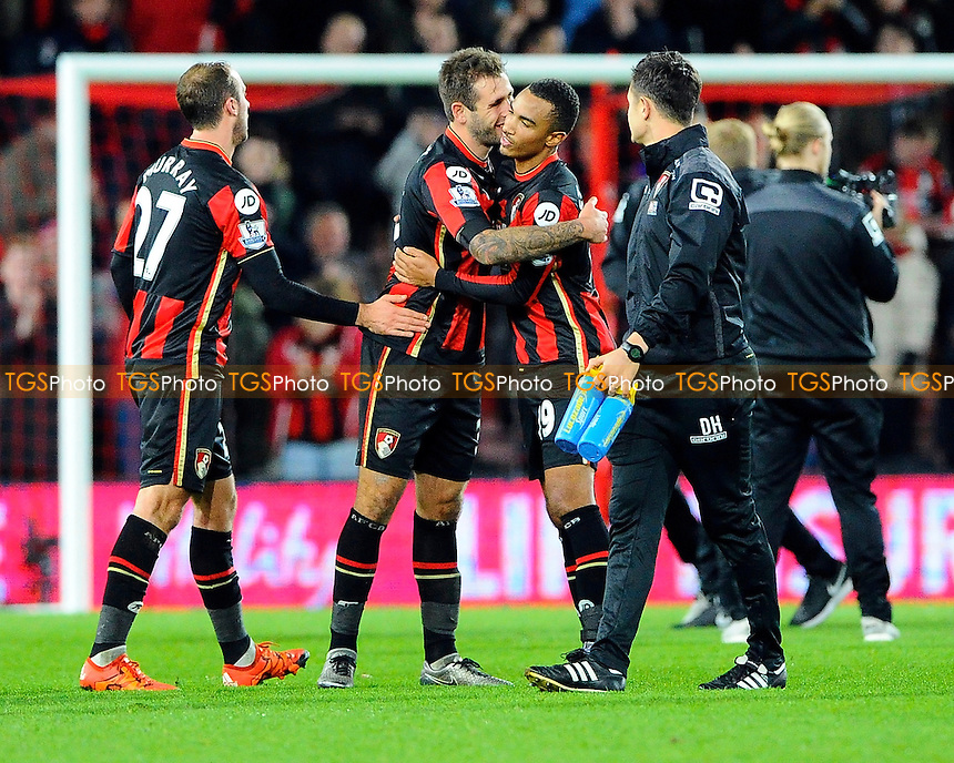 Steve Cook of AFC Bournemouth hugs Junior Stanislas of AFC Bournemouth at the final whistle during AFC Bournemouth vs Manchester United at the Vitality Stadium