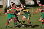 P. Tavia looks to pass to T. Parry as he is taken in a tackle by K. Farrell. Counties Manukau Premier Club Rugby, Pukekohe v Waiuku  played at the Colin Lawrie field, on the 3rd of 2006.Pukekohe won 36 - 14