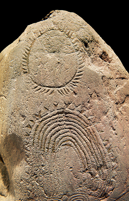"""Prehistoric  petroglyphs, rock carvings, of geometric designs carved by the the prehistoric Camuni people in the Copper Age around the 3rd milleneum BC, Stele """"Bagnolo 2"""" found in 1972 from Malegno near Bangnolo Ceresolo. Museo Nazionale della Preistoria della Valle Camonica ( National Museum of Prehistory in Valle Cominca ), Lombardy, Italy. Black Background"""