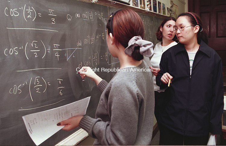MIDDLEBURY, CT 11/5/98--1105TK11.tif  (left to right:)Jungmin Lee, Dongso Jang and Sonia Erlich  ponder a solution to a calculus problem.--TOM KABELKA staff photo for Mark Azzara TodayÕs Woman story.  (Filed in Scans/Scan-In)