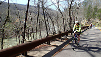 NWA Democrat-Gazette/FLIP PUTTHOFF <br /> Karen Mowry rides March 26 2017 along Arkansas 2015, the Mulberry River Road Scenic Byway.