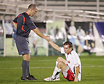 14 November 2008: Referee Brent Sorg (left) and Maryland's Jason Herrick (right). The University of Maryland defeated Boston College 1-0 at WakeMed Stadium at WakeMed Soccer Park in Cary, NC in a men's ACC tournament semifinal game.