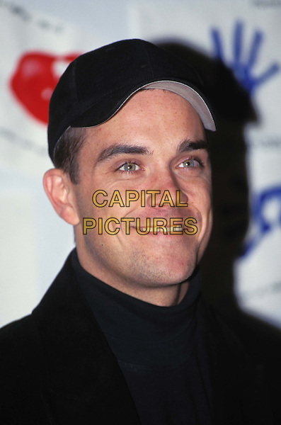 ROBBIE WILLIAMS.Ref: 9111.cap, headshot, portrait.*RAW SCAN - photo will be adjusted for publication*.www.capitalpictures.com.sales@capitalpictures.com.© Capital Pictures