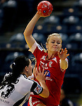 BELGRADE, SERBIA - DECEMBER 15:  Stine Jorgensen (R) of Denmark is challenged by Anna Punko of Russia (L) during the Women's European Handball Championship 2012 fifth place match between Denmark and Russia at Arena Hall on December 15, 2012 in Belgrade, Serbia. (Photo by Srdjan Stevanovic/Getty Images)