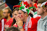 Welsh supporters react during the first half of match at  the UEFA EURO 2016 fan zone set up in the Principality Stadium, Cardiff, Wales, Britain, 6 July 2016, watching Portugal vs Wales EURO 2016 semi-final match. Athena Picture Agency/ALED LLYWELYN/ATHENA PICTURES
