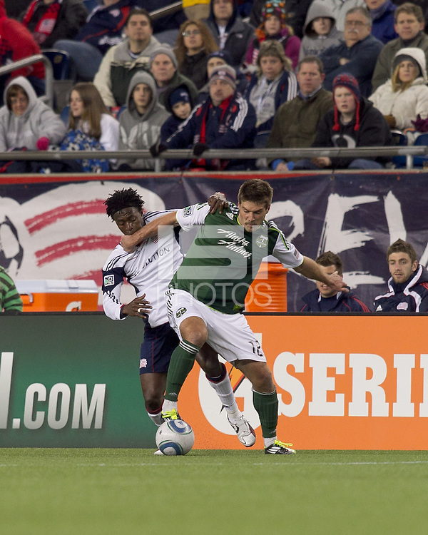 New England Revolution forward Kenny Mansally (7) and Portland Timbers defender David Horst (12) battle for the ball. In a Major League Soccer (MLS) match, the New England Revolution tied the Portland Timbers, 1-1, at Gillette Stadium on April 2, 2011.