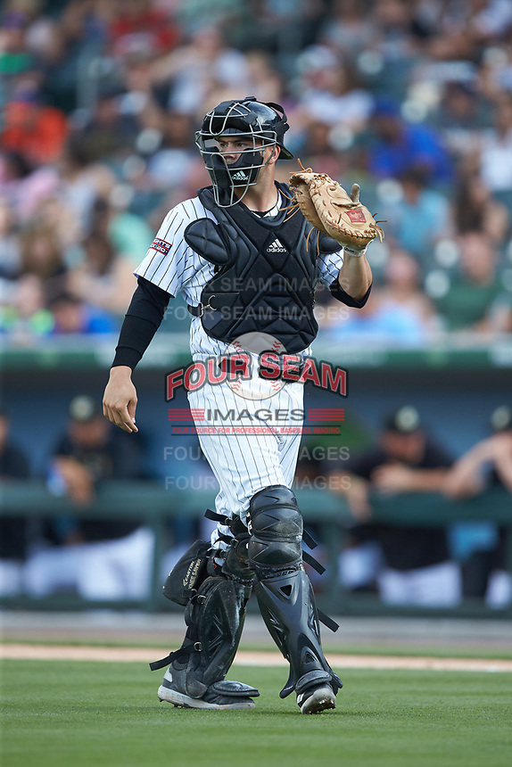 Charlotte Knights catcher Brett Austin (22) on defense against the Indianapolis Indians at BB&T BallPark on May 26, 2018 in Charlotte, North Carolina. The Indians defeated the Knights 6-2.  (Brian Westerholt/Four Seam Images)